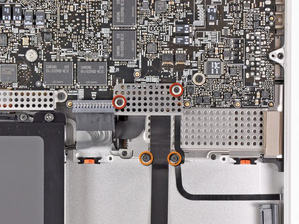 Remove the following four screws securing the hard drive cable assembly to the upper case: