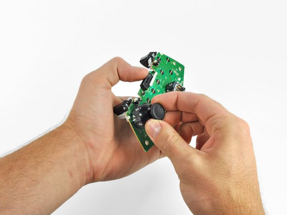 Remove the left analog stick cover using the same procedure previously described.