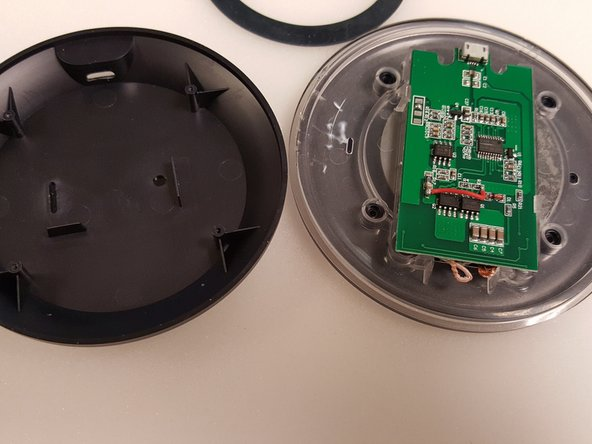 Gently pry bottom cover off of device.  This will expose the circuit board.