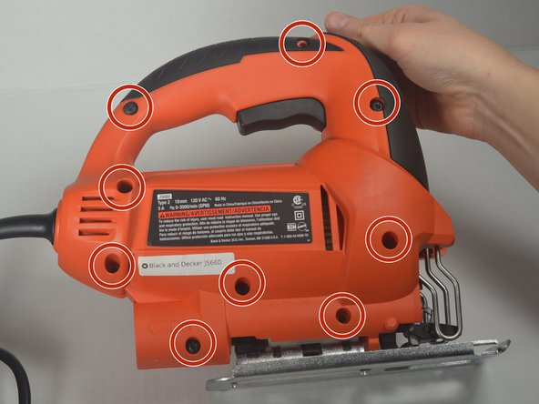 Remove the nine torx 15.875mm  screws on the front of the jigsaw using a T-15 torx screwdriver.