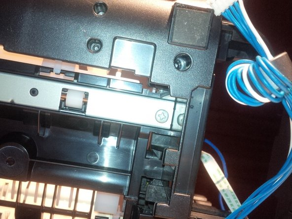 now remove the metal plate (long) , 4 screws in total. 1 screw is attached at an PCB board.