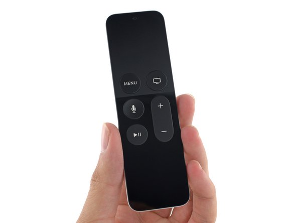 Behold, the new Siri Remote! Featuring dual microphones, a Glass Touch surface,   and a Lightning connector, this remote is definitely a bit more complex than the  Apple Remote of yesteryear.