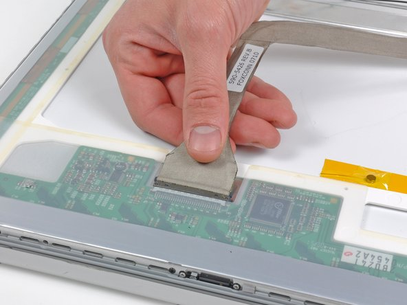 Pull the display data cable straight away from its socket on the LCD.