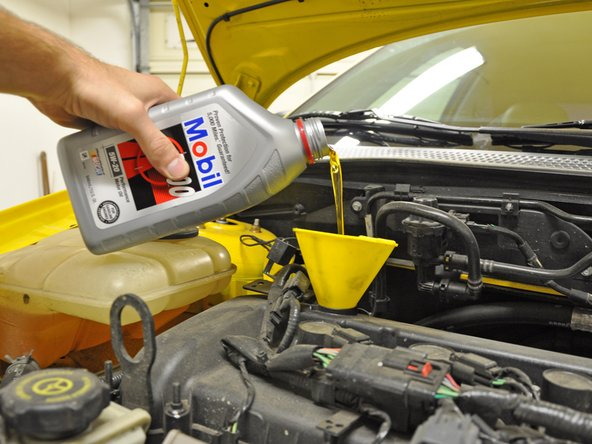 This step is only necessary if you wish to flush all of the old oil from your engine. You may consider doing this if it has been an especially long time since your last oil change or if some foreign liquid has been poured into the filler hole.