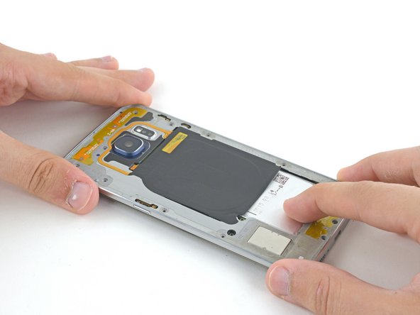 Press down on the back of the battery and lift up on the edges of the midframe to separate it from the rest of the phone.