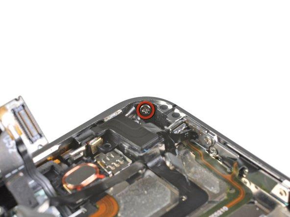 Remove the 1.6 mm Phillips screw near the headphone jack.