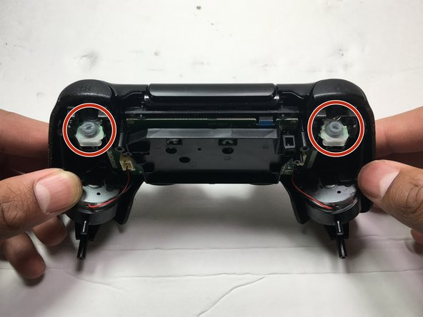 Examine the controllers rubber guards to see if it needs to be replaced or simply needs to be readjusted. If it is damaged, replace the rubber guard with a new one for the correct model, then, proceed to the next step. If not, proceed to the next step.