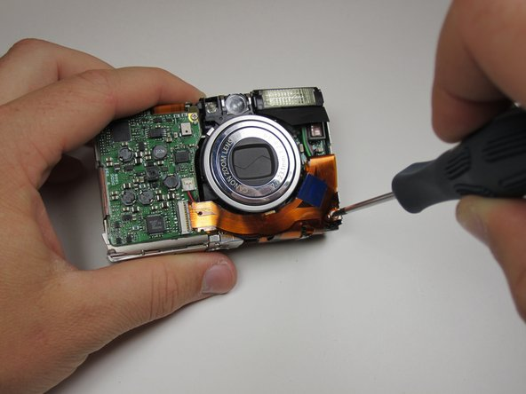 Once the image sensor is removed, turn the camera over and find the screw in the bottom right corner.