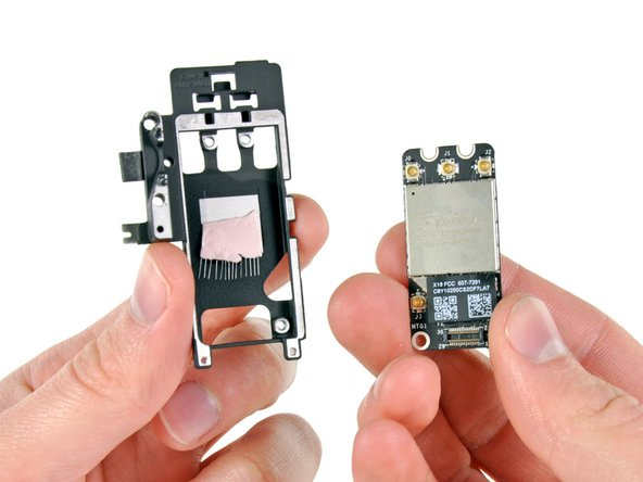 Remove the AirPort/Bluetooth board from its bracket.