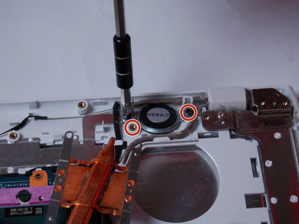 Using a Phillips #0 screwdriver, remove the two screws (Length: 7.7 mm) that hold the speaker in place.