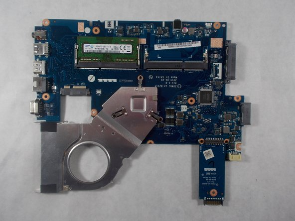Remove the board from the laptop body, flip over for access to the ram