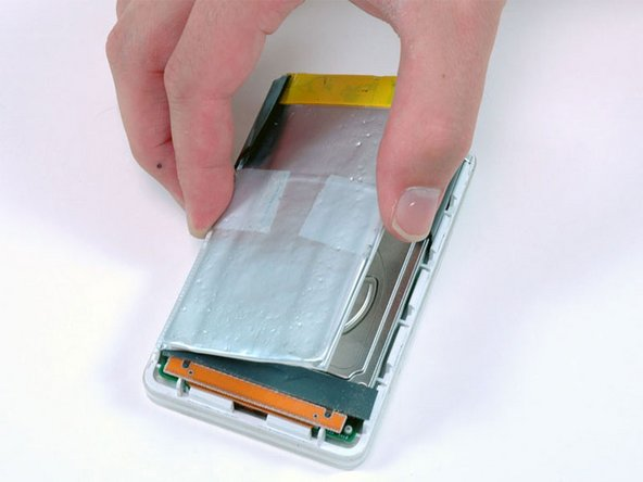 Lift the battery up from the adhesive holding it to the iPod.