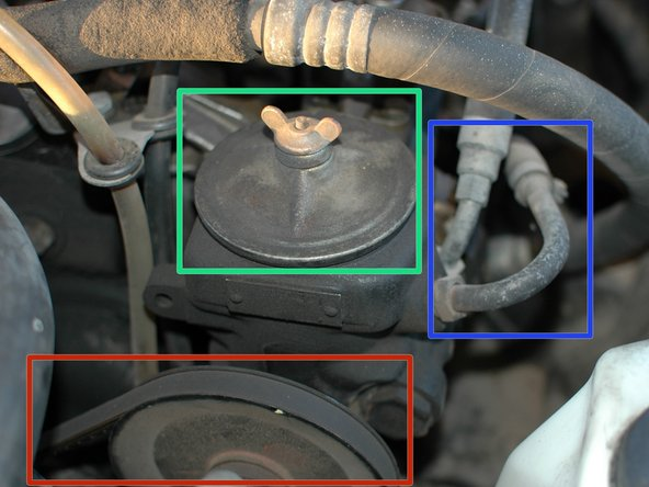 Your power steering fluid reservoir is located within the pump which is on the right side of your engine, when facing it from the front of the car. In the U.S. this is the driver's side. Attached to it are the following components: