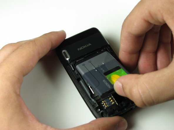 Remove the battery from the phone by hand.