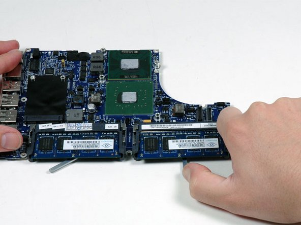 Pull back on the metal lever and slide the RAM chip out of the logic board.