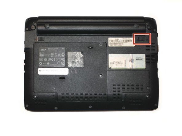Place the netbook bottom-side-up on a flat surface.