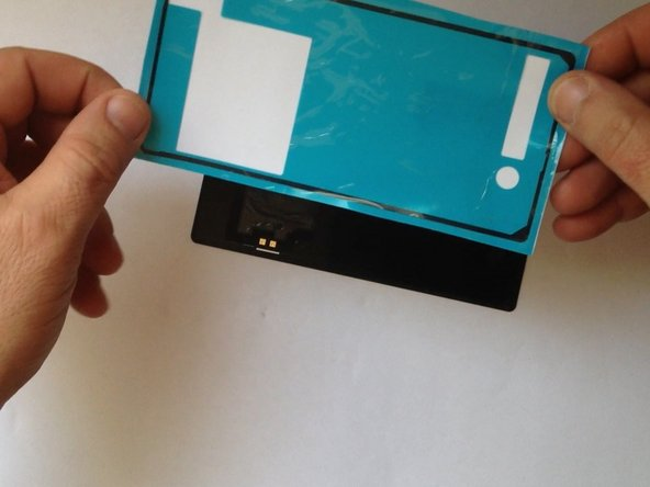 Use again adhesive sticker to atach the back / battery cover.