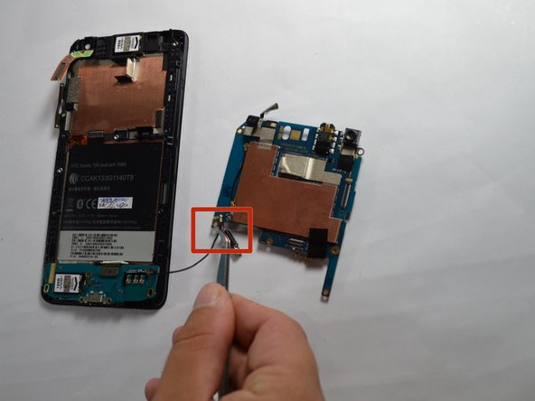 Unsnap the wire from the printed circuit board (PCB) using the tweezers.