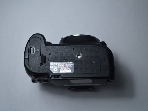 Turn the camera on its bottom to reveal the battery door.
