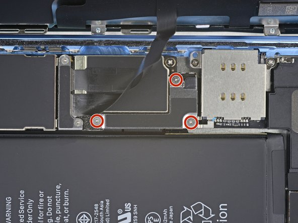 Remove three 1.2 mm Y000 screws securing the battery connector cover bracket.