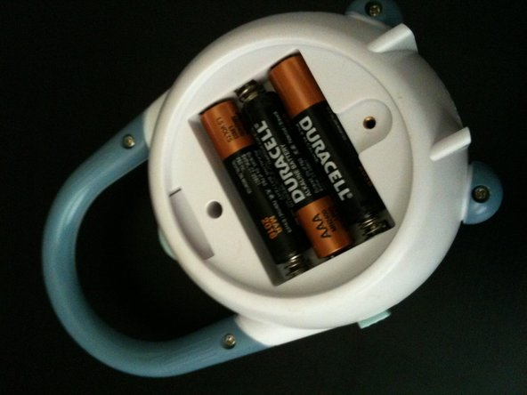 Remove the batteries from the compartment.