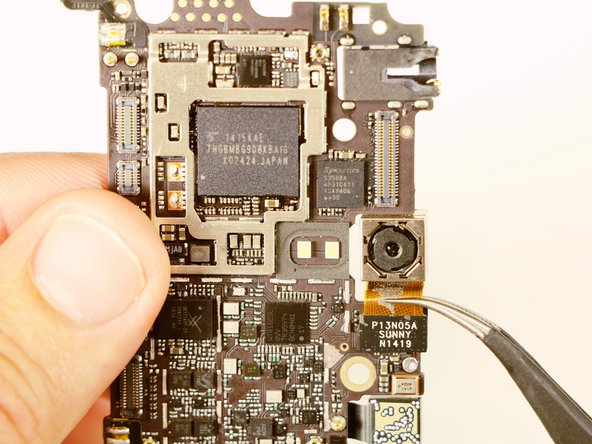 Once the motherboard has been removed simply pry off the rear facing camera with a spudger or angled tweezers.