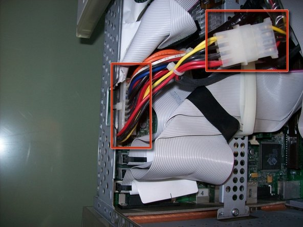 Part A: Use your index finger to pinch the clip on the main power plug while pulling it up from the motherboard.