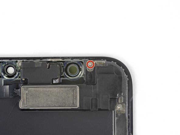 Remove the 1.2 mm Y000 screw on the back of the display assembly, near the infrared camera port.