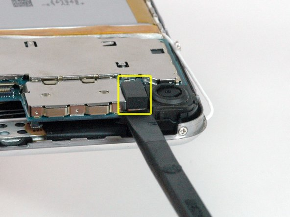 Use a spudger to disconnect the camera connector.
