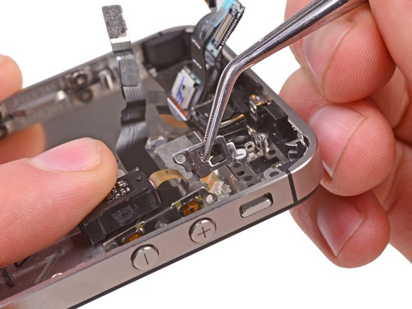 Use a pair of tweezers to gently pull the silent switch bracket away from the outer case.