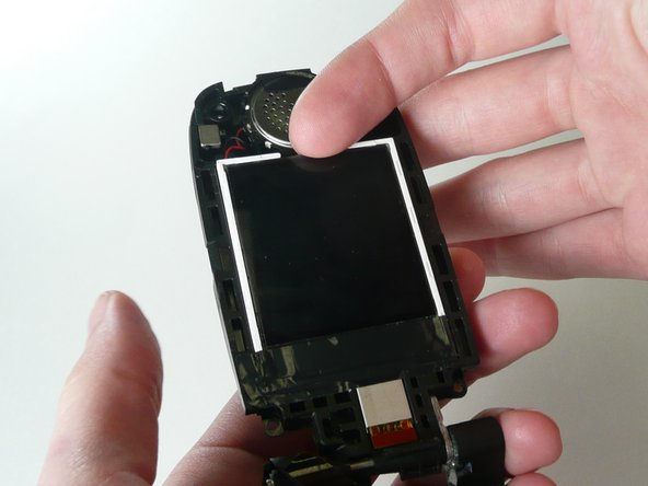 Remove the tape on the bottom of the screen so that the screen will be able to come out.