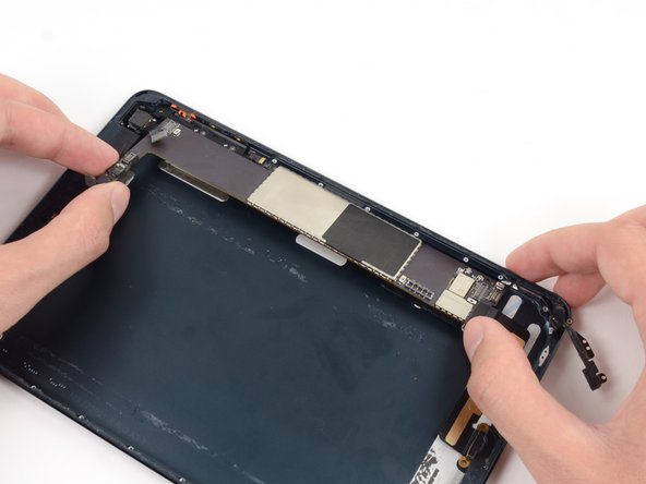 Lift the end of the logic board nearest the front-facing camera to ensure it is free of adhesive.