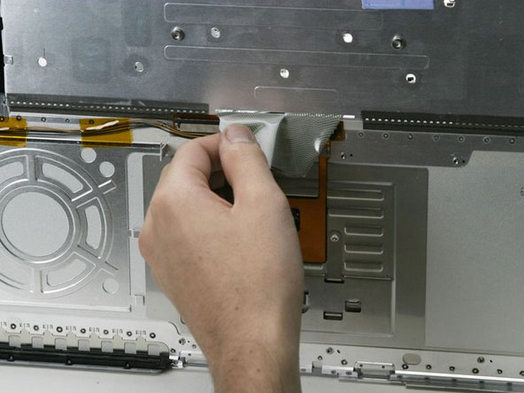 Turn the casing over and work the grey keyboard ribbon through the slot.