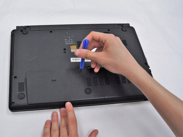 Use a plastic opening tool to pry open the rectangular panel the 9.0 mm screw was removed from.