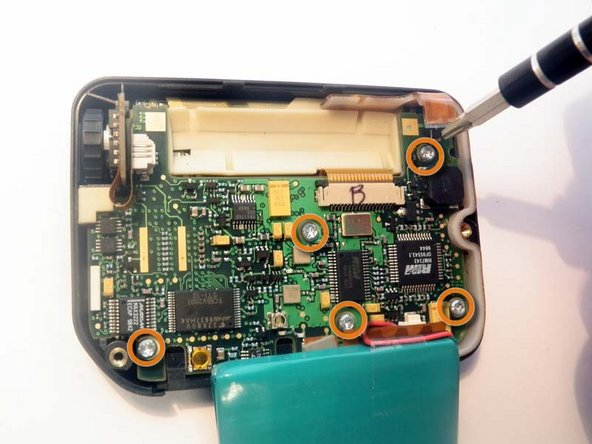 Use the T9 Screwdriver to remove the five visible screws: Top right, bottom right, middle center, bottom center, bottom left.