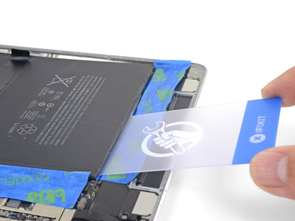 Use a plastic card to slice through the third adhesive strip.