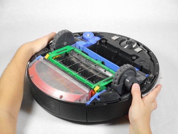 Rotate the Roomba so the bumper is in front of you.