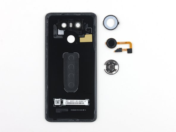The rear button is covered by a reinforcement bracket that is adhered to the rear case. Presumably this makes the button less likely to fail, and may protect the rear case as well.