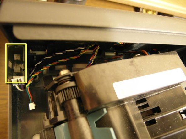 After removing the paper feeder, you will notice the slotted opto switch.