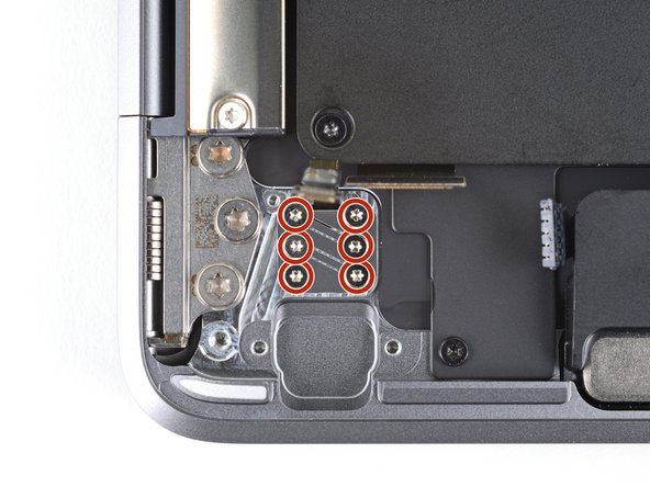 Use a T3 Torx driver to remove the six 1.6mm screws securing the Touch ID sensor and its bracket.
