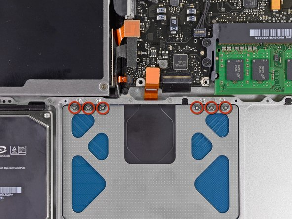 Remove the six 1.4 mm Y0 Tri-point screws securing the trackpad to the upper case.