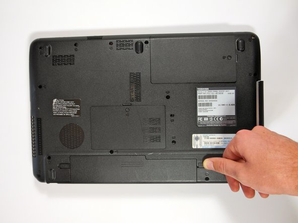 Turn over device to view the underside of the laptop, with the battery closest to you.  Unlock the switch on the right side of the battery.