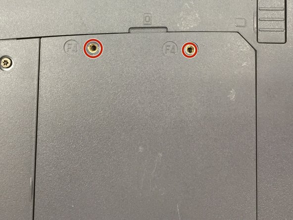 Remove two Phillips #00 screws labeled F4.