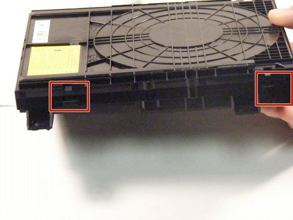 To replace the disc tray open the disk hub and unsnap the sides of the device.