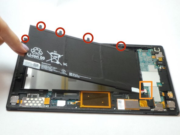 Remove all screws connecting the battery to the tablet. Location of screws shown with red circles.