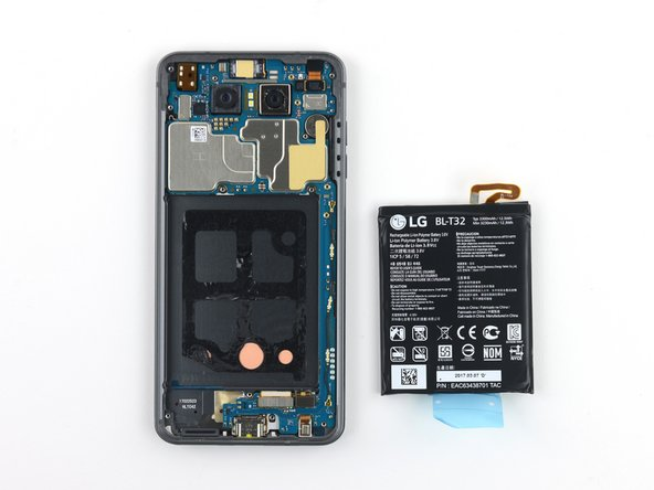 The battery can now be removed. The blue plastic tab on the battery appears to be intended to aid removal. It helps a bit, but breaks easily at the wrong angle.