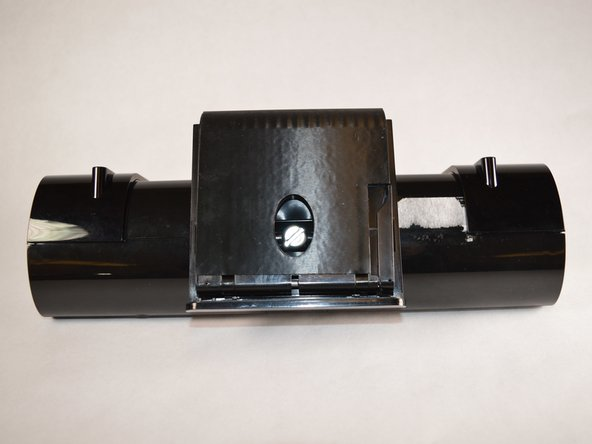 Locate and release the flap on the side of your device's mount.  This will allow you to slide the adjustable portion of the mount.