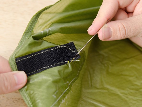 Continue bringing the needle up and down through both layers of fabric, as in steps 2 and 3 of this guide, working your way around the material.