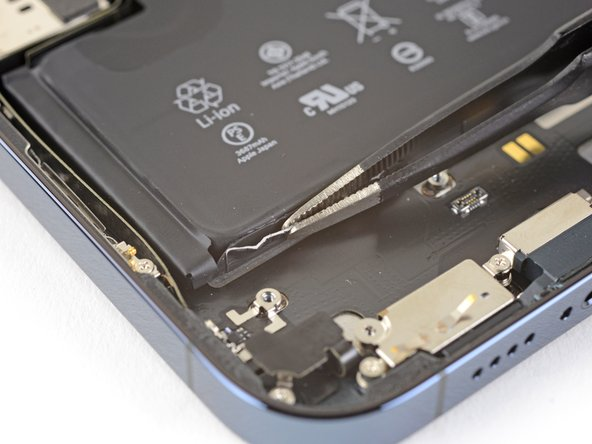 Peel down the first battery adhesive pull-tab to un-stick it from the bottom edge of the battery.