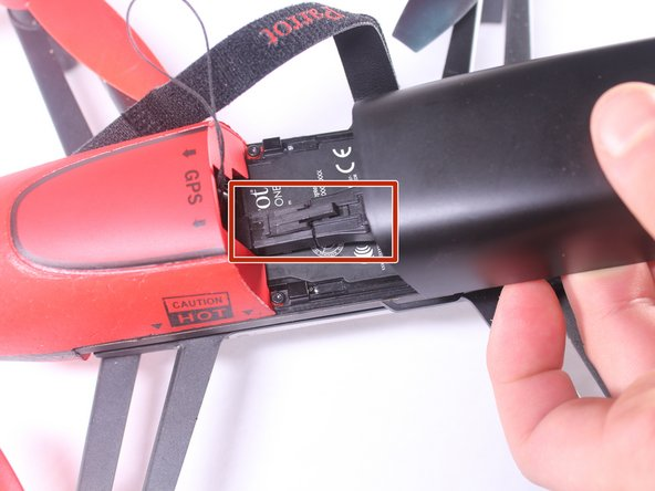 Once the battery is separated from the nose, push down on the connector and pull the battery away from the connector.